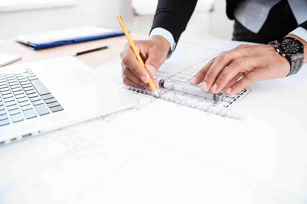 Close-up of businessman hands pointing pen to chart