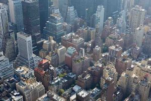 New York City aerial view with skyscrapers, sunlight and mist