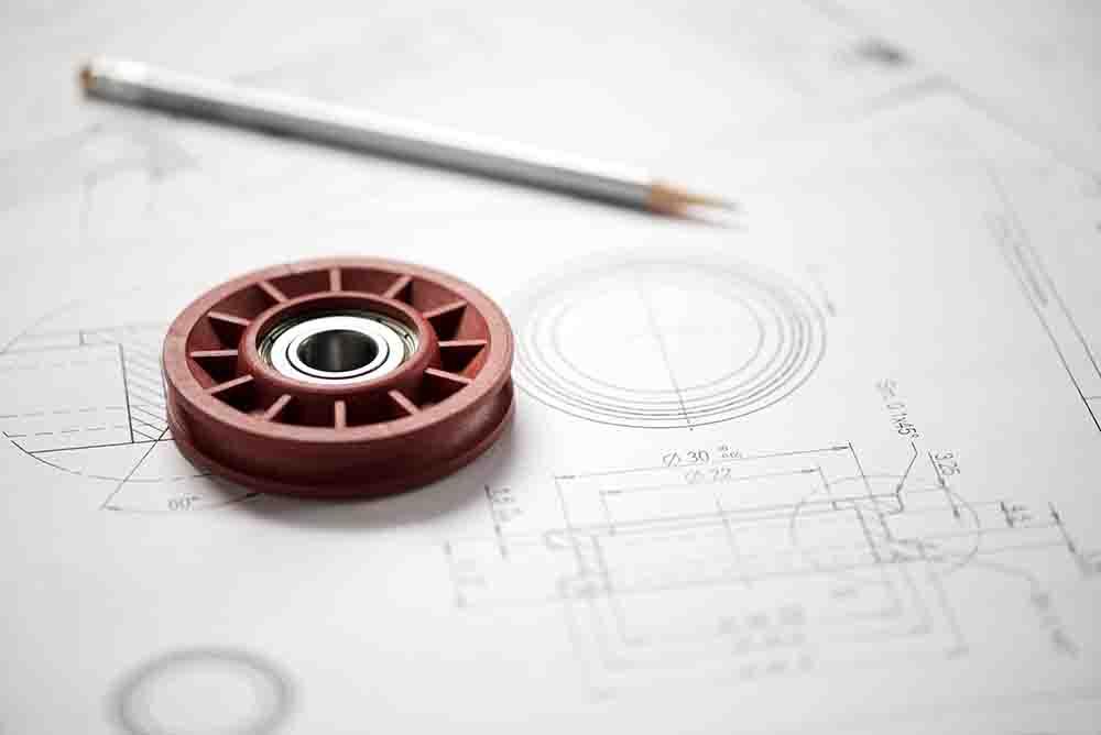 Plastic wheel bearing on blueprint