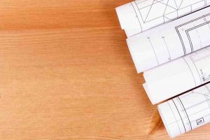 Rolls of electrical blueprints for engineer jobs, copy space for text on board